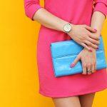 Outdoor trendy girl near yellow street wall .Stylish pink dress