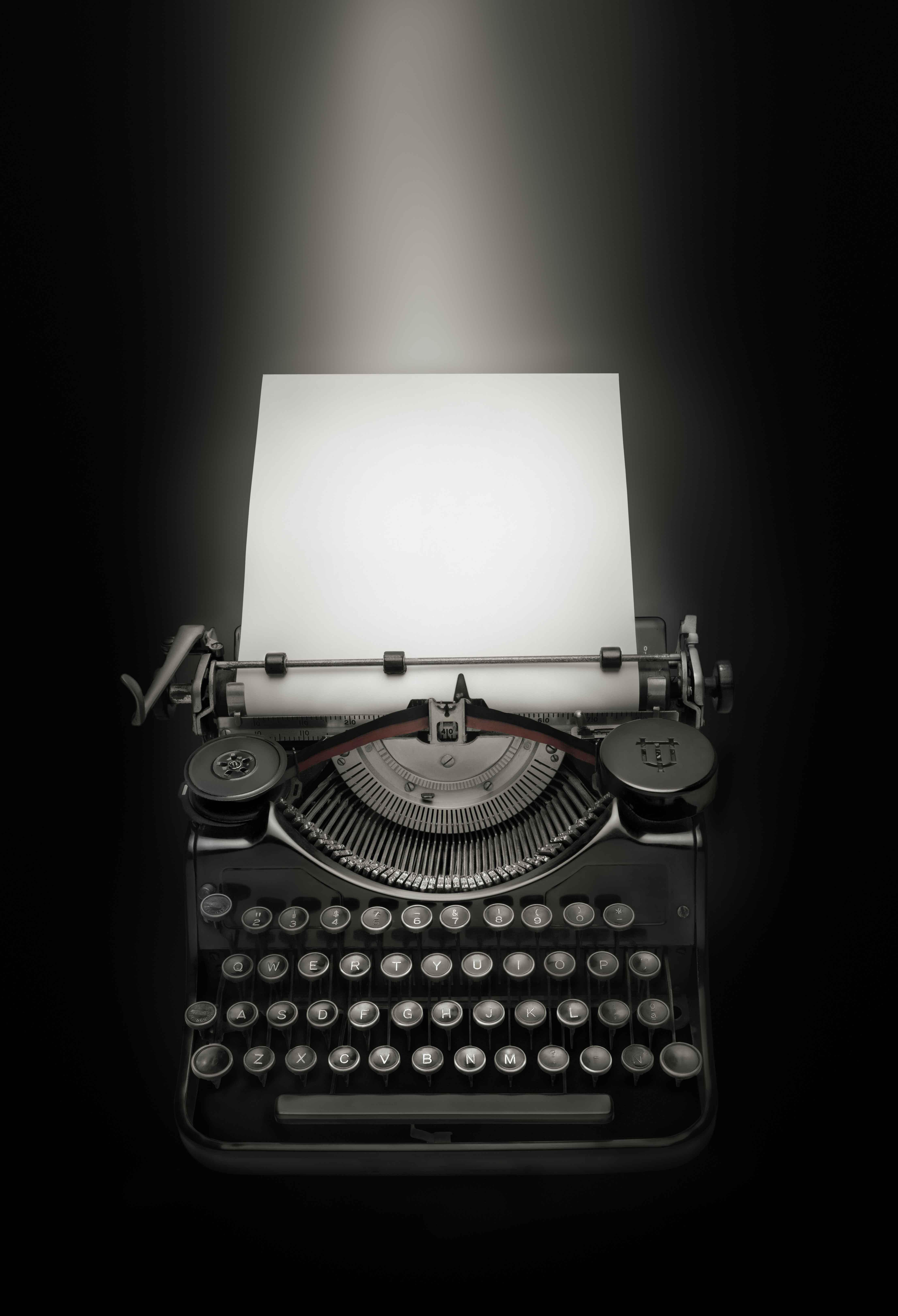 Vintage typewriter against black background